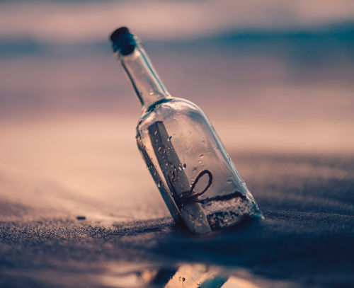Glass bottle washed up on the shore containing a message